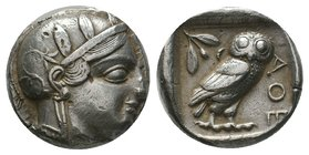 Attica, Athens AR Tetradrachm. Circa 479-450 BC. Head of Athena right, wearing earring, necklace, and crested Attic helmet decorated with three olive ...