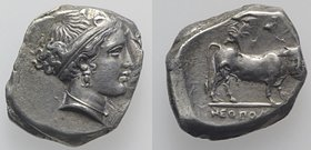 Southern Campania, Neapolis, c. 320-300 BC. AR Didrachm (23mm, 7.11g, 3h). Head of female r., hair in band. R/ Man-headed bull standing r., head facin...