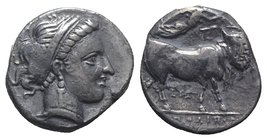 Southern Campania, Neapolis, c. 300 BC. AR Didrachm (19mm, 6.96g, 6h). Diademed head of nymph r., hair in band. R/ Man-headed bull standing r., head f...