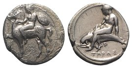 Southern Apulia, Tarentum, c. 390-385 BC. AR Nomos (21mm, 7.38g, 8h). Nude youth, holding rein and shield, on horseback l.; A below. R/ Phalanthos on ...
