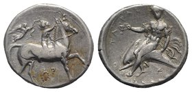 Southern Apulia, Tarentum, c. 330-325 BC. AR Nomos (22mm, 7.86g, 12h). Youth on horseback r., crowning horse; to l., Nike flying r., crowning rider wi...