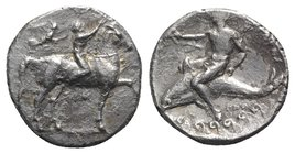 Southern Apulia, Tarentum, c. 330-325 BC. AR Nomos (21mm, 7.79g, 3h). Youth on horseback r., crowning horse; to l., Nike flying r., crowning rider wit...