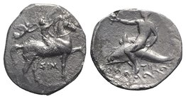 Southern Apulia, Tarentum, c. 330-325 BC. AR Nomos (22mm, 7.61g, 3h). Youth on horseback r., crowning horse; to l., Nike flying r., crowning rider wit...
