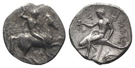 Southern Apulia, Tarentum, c. 315-302 BC. AR Nomos (20mm, 7.04g, 6h). Warrior, holding shield and two spears, preparing to cast a third, on horseback ...