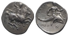 Southern Apulia, Tarentum, c. 315-302 BC. AR Nomos (22mm, 7.61g, 7h). Warrior, holding shield and two spears, preparing to cast a third, on horseback ...