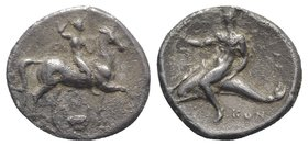 Southern Apulia, Tarentum, c. 302 BC. AR Nomos (23mm, 7.33g, 6h). Nude youth, crowning himself, on horseback r.; below, ΣA above Ionic capital. R/ Pha...