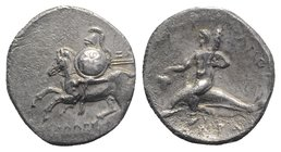 Southern Apulia, Tarentum, c. 280-272 BC. AR Nomos (20mm, 6.25g, 7h). Horseman l., holding shield and two spears. R/ Phalanthos riding dolphin l., hol...