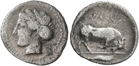 SICILY. Katane. Circa 405-403/2 BC. Litra (Silver, 12 mm, 0.69 g, 10 h). Head of a nymph to left, wearing hair in sphendone. Rev. KATANAIΩN Bull butti...