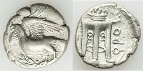 BRUTTIUM. Croton. Ca. 350-300 BC. AR stater (20mm, 6.91 gm, 9h). VF, brushed, Eagle standing left on olive branch, head raised and wings displayed / Ϙ...