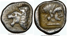 CARIA. Cnidus. Ca. 490-465 BC. AR hemiobol (7mm, 9h). NGC VF. Head of roaring male lion left / Head of Aphrodite right of heavily archaized style, hai...