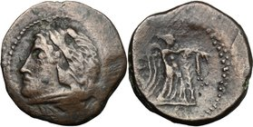 Greek Italy. Northern Apulia, Ausculum. AE 19mm, c. 240 BC. D/ Head of Heracles left wearing lion's skin. R/ Nike standing right, attaching taenia wit...
