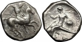 Greek Italy. Southern Apulia, Tarentum. AR Nomos, c. 332-302 BC. D/ Armed horseman galloping right, spearing downwards. R/ Dolphin rider left, with tr...