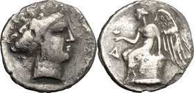 Greek Italy. Bruttium, Terina. AR Drachm, c. 300 BC. D/ Female head right. R/ Nike seated left on cippus, holding bird on hand; to left, Δ. HN Italy 2...