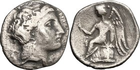 Greek Italy. Bruttium, Terina. AR Drachm, c. 300 BC. D/ Female head right. R/ Nike seated left on cippus, holding caduceus (?). HN Italy 2642. SNG ANS...