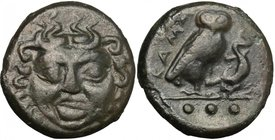 Sicily. Kamarina. AE Tetras, 425-405 BC. D/ Gorgoneion facing. R/ Owl standing right, head facing, grasping lizard; in exergue, three pellets. CNS III...