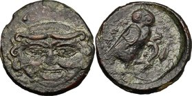 Sicily. Kamarina. AE Oncia, circa 420-410 BC. D/ Gorgoneion. R/ Owl standing right, grasping lizard; in exergue, pellet. CNS III, 7. AE. g. 1.31 mm. 1...