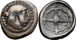Sicily. Syracuse. AR Litra, 480-470 BC. D/ Head of Arethusa right. R/ Wheel with four spokes. SNG Cop. 627. AR. g. 0.88 mm. 10.00 Heavily toned. VF/Ab...