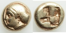 IONIA. Phocaea. Ca. 477-388 BC. EL sixth-stater or hecte (10mm, 2.55 gm). Fine. Female head left, hair bound in netted saccos and sphendone; seal swim...
