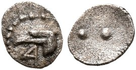 SICILY. Akragas. Circa 460s-440s BC. Hexas - Dionkion (Silver, 5 mm, 0.06 g). Head of an eagle to left; before, A. Rev. •• (mark of value) within shal...