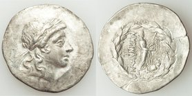 AEOLIS. Myrina. Ca. mid-2nd century BC. AR tetradrachm (33mm, 15.55 gm, 12h). About VF, scrape. Laureate head of Apollo right, hair falling in two lon...