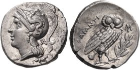 CALABRIA. Tarentum. Circa 240-228 BC. Drachm (Silver, 16 mm, 3.27 g, 3 h). Head of Athena to left, wearing crested Attic helmet with Skylla on the bow...