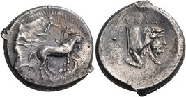 SICILY. Gela. Circa 450-440 BC. Tetradrachm (Silver, 27.5 mm, 16.84 g, 2 h). Male charioteer driving quadriga walking slowly to the right; above, Nike...