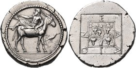 MACEDON. Mende. Circa 460-423 BC. Tetradrachm (Silver, 29 mm, 17.33 g, 6 h), c. 440-430 BC. Dionysos, bearded and wearing an ivy wreath and a himation...