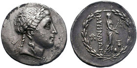 Aeolis, Myrina AR Tetradrachm. Circa 160-143 BC. Stephanophoric type. Laureate head of Apollo right / Apollo Grynios standing right, holding phiale in...