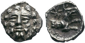 Cilicia, Uncertain mint. 4th century B.C. AR obol . Facing head of Herakles, with club; H to leftc / Forepart of wolf right; star above. Göktürk 68-9,...