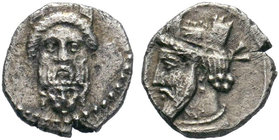 Cilicia, Uncertain mint AR Obol. 4th century BC. Bearded head facing, wearing kalathos, set upon head of lion facing / Bearded head left, wearing kala...