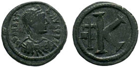 BYZANTINE.Justinian I, AE Half-follis. Constantinople. DN IVSTINIANVS PP AVG, pearl diademed, draped, cuirassed bust right / Large K, long cross to le...