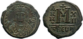 BYZANTINE.BYZANTINE.Maurice Tiberius, 582-602 AD, AE Follis. Antioch as Theopolis. Garbled legend, crowned and mantled bust facing, holding mappa and ...