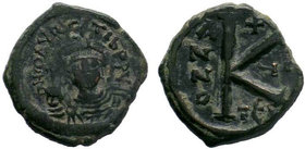 BYZANTINE.Maurice Tiberius, 582-602 AD, AE Half follis. Thessalonica. DN MAVRC TIB PP AVG, helmeted and cuirassed or crowned and cuirassed bust facing...