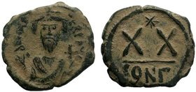 BYZANTINE.Phocas. 602-610 AD. AE Half follis. Constantinople. DM FOCA PERP AVG, crowned, mantled bust facing, holding mappa and cross / Large XX, cros...