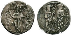 BYZANTINE.Andronicus II and Michael IX. 1295-1320. AR Basilikon 2.10 gm. Constantinople mint. Christ seated facing, sometimes with star to left and ri...
