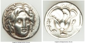 CARIAN ISLANDS. Rhodes. Ca. 305-275 BC. AR didrachm (19mm, 6.73 gm, 12h). VF, edge marks. Head of Helios facing, turned slightly right, hair parted in...
