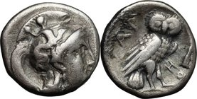 Greek Italy.Southern Apulia, Tarentum.AR Drachm, 302-280 BC.D/ Head of Athena right, wearing helmet decorated with Scylla hurling rock.R/ Owl standing...