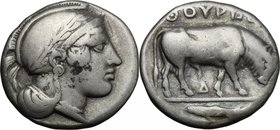 Greek Italy.Southern Lucania, Thurium.AR Stater, 443-400 BC.D/ Head of Athena right, wearing helmet decorated with wreath.R/ Bull right; in exergue, f...