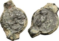 Sicily.Kamarina.AE Oncia, 420-405 BC.D/ Gorgoneion.R/ Owl standing right, holding lizard.SNG Cop. -. Westermark-Jenkins 177.AE.g. 1.83 mm. 16.50Irregu...