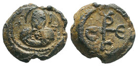 Lead seal of Sergios (7th cent.) Diam.: mm Weight: gr. Condition: F/VF. Attractive brown natural patina. Obverse: The bust Mother of God, en face, hol...