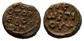Lead seal of George (7th cent.) Diam.: mm Weight: gr. Condition: VF. Brown natural patina. Obverse: Inscription in 4 lines: + ΘΕΟΤΟΚΕ ΒΟΗΘΗ + (Mother ...
