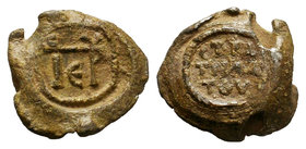 Lead seal of Petros stratelates, (6th cent.) Diam.: mm Weight: gr. Condition: VF. Brown natural patina. It is to mention the lenticular shape of the s...