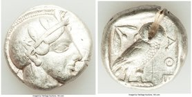 ATTICA. Athens. Ca. 455-440 BC. AR tetradrachm (23mm, 17.15 gm, 8h). About VF, bent, test cut, graffito. Early transitional issue. Head of Athena righ...