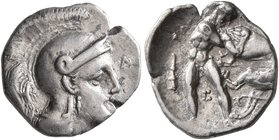 CALABRIA. Tarentum. Circa 325-280 BC. Diobol (Silver, 13 mm, 1.00 g, 11 h). Head of Athena to right, wearing crested Attic helmet; before, Λ; below ch...