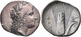 LUCANIA. Metapontion. Circa 330-290 BC. Didrachm or Nomos (Silver, 23 mm, 7.92 g, 5 h). Head of Demeter to right, wearing wreath of grain ears, triple...