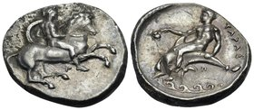 CALABRIA. Tarentum. Circa 344-340 BC. Nomos (Silver, 22 mm, 7.67 g, 3 h). Helmeted ephebe, nude, holding a small round shield and a lance with his lef...