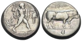 LUCANIA. Poseidonia. Circa 410-350 BC. Nomos (Silver, 17.5 mm, 7.65 g, 8 h). Poseidon striding to right, brandishing trident and with chlamys over his...