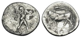 LUCANIA. Poseidonia. Circa 410-350 BC. Obol (Silver, 9.5 mm, 0.38 g, 9 h). ΠOΣE Poseidon striding to right, brandishing trident. Rev. Bull standing to...