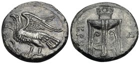BRUTTIUM. Kroton. Circa 350-300 BC. Nomos (Silver, 21.5 mm, 7.47 g, 7 h). Eagle with spread wings, standing left on olive branch. Rev. KPO Tripod; to ...