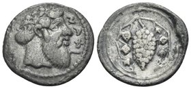 SICILY. Naxos. Circa 461-430 BC. Litra (Silver, 12 mm, 0.62 g, 1 h). NAXI Head of bearded Dionysos to right, wearing ivy wreath. Rev. Grape bunch on v...